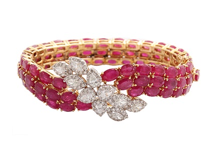Bracelet by ANMOL crafted in 18 K gold and set with rubies, marquise, drop diamonds and round brilliant diamonds