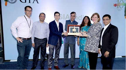 Praveenshankar Pandya, Chairman of the GJEPC, presented a plaque commemorating the 10th anniversary of the GIA India laboratory to Susan Jacques, GIA President and CEO and Tom Moses, GIA Executive Vice President and Chief Laboratory and Research Officer. Pictured (left to right) are: Matt Hall, GIA Vice President for Regional Laboratory Operations (Europe, Middle East and Africa); Russell Mehta, Managing Director of Rosy Blue (India); Tom Moses; Praveenshankar Pandya; Nirupa Bhatt, Managing Director for GIA India and Middle East; Susan Jacques; Sriram Natarajan, Vice President of Operations, GIA India laboratory.