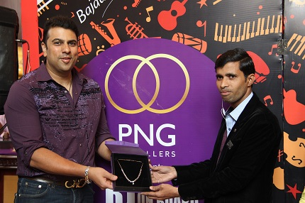 Saurabh Gadgil, CMD, PNG Jewellers with the winner of the contest