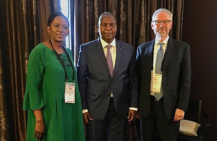 Faustin Archange Touadera (center), President of the Central African Republic, flanked by Marie-Chantal Kaninda (left), Executive Director of the World Diamond Council, and Stephane Fischler (right), WDC President, during the 6th Forum of the Africa-Belgium Business Week in Genval, Belgium.