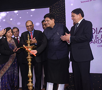 Minister of Commerce & Industry Mr Piyush Goyal lighting the lamp at the inaugural ceremony with Chairman GJEPC Pramod Agrawal and other dignitaries
