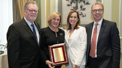 Susan Jacques accepted the Stanley Schechter Award at the Jewelers Vigilance Committee (JVC) luncheon on Jan. 10, 2020. From left: Joel Schechter, retired CEO of Honora; Susan Jacques, GIA president and CEO; Tiffany Stevens, JVC CEO and general counsel; and Charles Stanley, president of Forevermark US and 2020 Chairman of the JVC Board