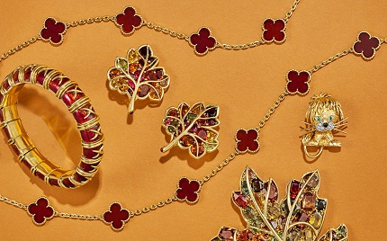From Left to Right:  VAN CLEEF & ARPELS CARNELIAN AND GOLD