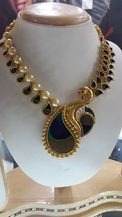 Necklace wherein peacock feathers have been incorporated in the design. Courtesy: Paras Chain