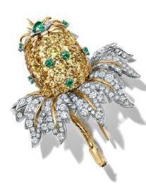 Tiffany & Co. Schlumberger® clip in platinum and 18k yellow gold with yellow sapphires, emeralds and diamonds